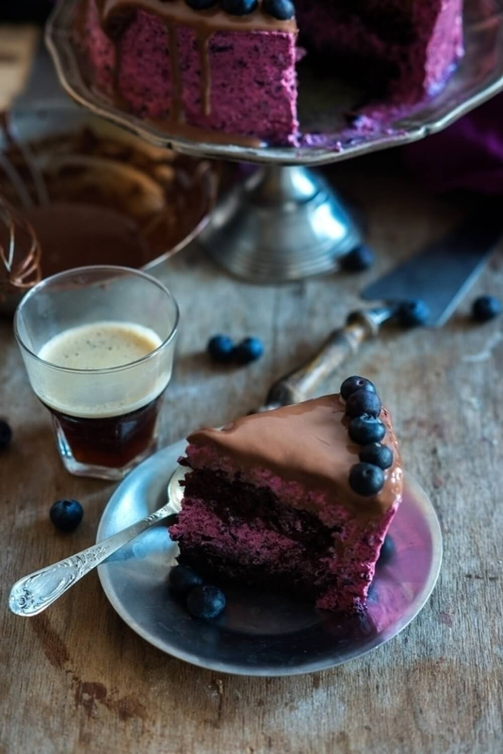 A chocolate cake with blueberry mousse
