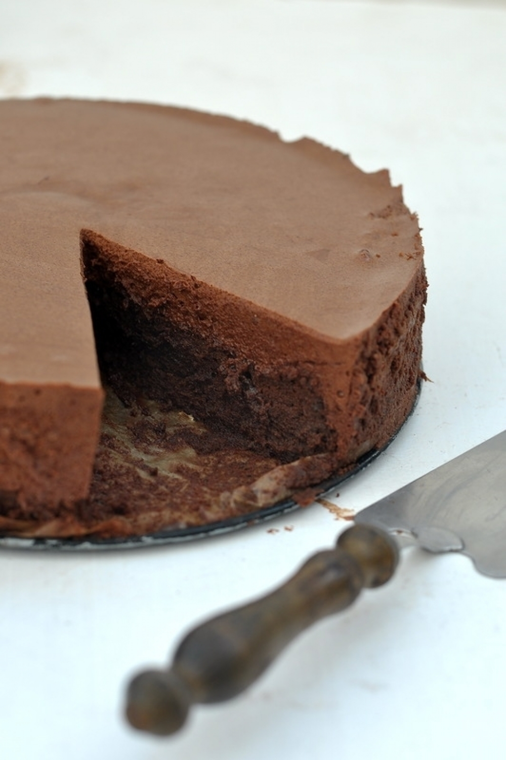 A chocolate cake with chocolate mousse
